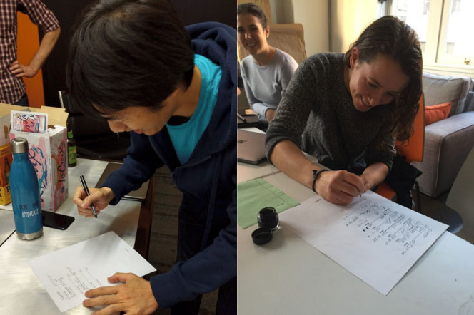 Angaza Engineers, Davis Shih and Alison Polton-Simon, sign the Engineering Constitution in San Francisco, California