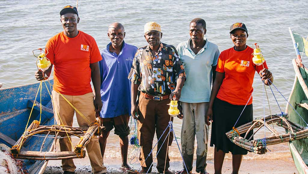 Mwezi with their clients, who use pay-as-you-go OvCatch lamps for night fishing